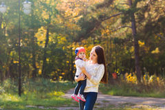 Young mother walking with her baby in an autumn Royalty Free Stock Image