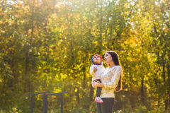 Young mother walking with her baby in an autumn Stock Photography