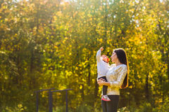 Young mother walking with her baby in an autumn Stock Image