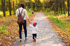 Young mother walking with her baby in an autumn Royalty Free Stock Images