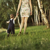 Young mother walking with her child Stock Image