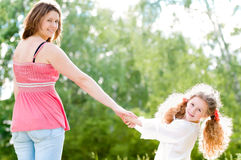 Young mother walking with her daughter Royalty Free Stock Photos
