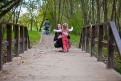 Young mother walking with her little daughter in Royalty Free Stock Images