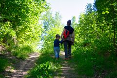 Young mother walking with her little son outdoors in summer Royalty Free Stock Images