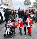 Young mother walking with little Santa Claus on Christmas market stock images