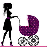 Young mother walking with stroller Stock Images
