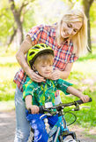 Young mother wears a bicycle helmet son stock image