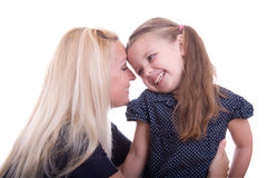 Young mother is whispering a secret Stock Photo