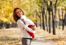 Free Young Mother With Sleeping Child In Autumn Park Royalty Free Stock Photography - 21609787