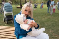 Young mother woman enjoying free time with her baby boy child - Caucasian white child with a parent`s hand visible - stock photo