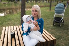 Young mother woman enjoying free time with her baby boy child - Caucasian white child with a parent`s hand visible - royalty free stock image