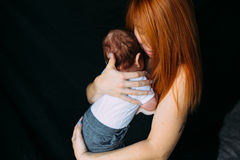 Young mother woman holding her child baby Stock Photo