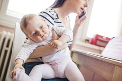 Young mother working from home Stock Photography