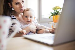 Young mother working from home Royalty Free Stock Image