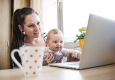 Young mother working from home Stock Image