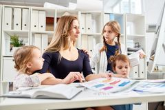 Young Mother Wrapped up in Work royalty free stock images
