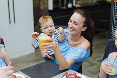 A young mother and a young son have breakfast Stock Photos
