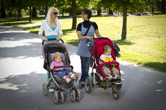 Young mothers in the park Royalty Free Stock Image