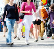 Young motion blurred (shopping) crowd on street Stock Photos