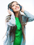 Young motion woman with headphones listening music .Music teena Stock Photography