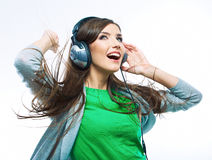 Young motion woman with headphones listening music .Music teena Royalty Free Stock Image