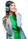 Young motion woman with headphones listening music .Music teena Stock Photo