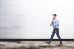 Free Young Motivation Businessman Talk Via Smart Phone While Walk Out Royalty Free Stock Images - 94923219