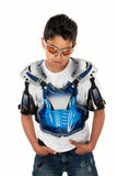 Young Motorcross Racer. Serious Latino youngster in motorcross gear and hands in pockets Royalty Free Stock Images