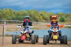Young Motorcyclists. SERPUKHOV, RUSSIA - OCTOBER 7, 2017: Juniors before start,  Class ATV-JUNIORS, in the 4 stage  MX series, the Red Wings Cup 2017 super Royalty Free Stock Images