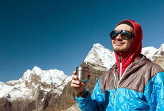 Young Mountain Climber having Refreshment from Thermo Cup Stock Image