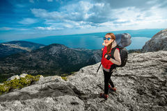 Young mountain climber on the top of island Stock Images