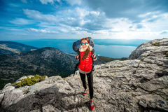 Young mountain climber on the top of island Royalty Free Stock Photos