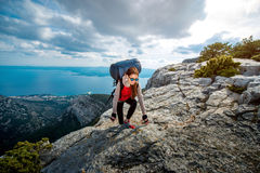 Young mountain climber on the top of island Royalty Free Stock Image