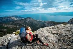 Young mountain climber on the top of island Stock Photos