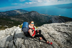 Young mountain climber on the top of island Stock Photography