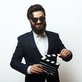Young movie director holding a clapperboard stock photos