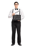 Young movie director holding a movie clapperboard Royalty Free Stock Image