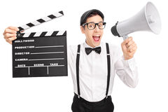 Young movie director speaking on a megaphone Royalty Free Stock Photography
