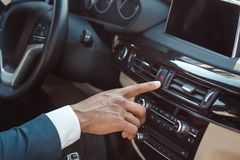 Young businessman driver sitting inside car pushing emergency alarm button close-up stock image