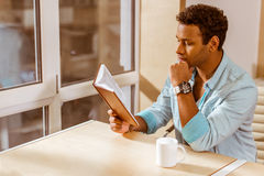 Young mulatto businessman working Stock Images