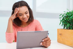 Young mulatto girl using tablet Royalty Free Stock Photos