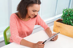 Young mulatto girl using tablet Royalty Free Stock Photo