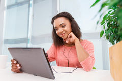 Young mulatto girl using tablet Stock Photography