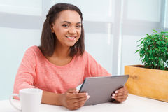 Young mulatto girl using tablet Stock Image