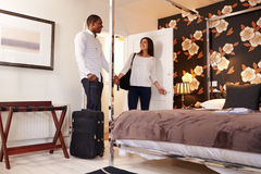 A young multi ethnic couple arriving at their hotel room Royalty Free Stock Image