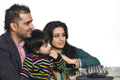 Young multi ethnic couple enjoying with their son Stock Photo