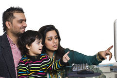 Young multi ethnic couple enjoying with their son Royalty Free Stock Photography