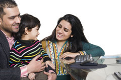 Young multi ethnic couple enjoying with their son. Happy multi ethnic family of three enjoying together Royalty Free Stock Photo