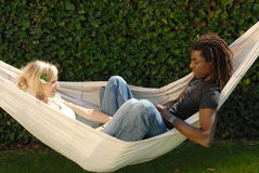 Young multi-ethnic couple in hammock royalty free stock image