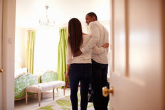 Young multi ethnic couple looking at a hotel room, back view Stock Photo